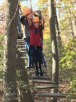 Students zip roping in outdoor educational experience