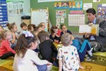Students being read to by Joe