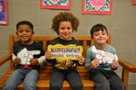 Students hold signs for showing kindness