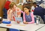 Sharon Holloway reading to student