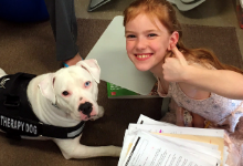 Therapy dog Reggie with student