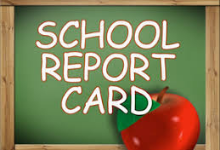 School REport card written on greenboard with apple
