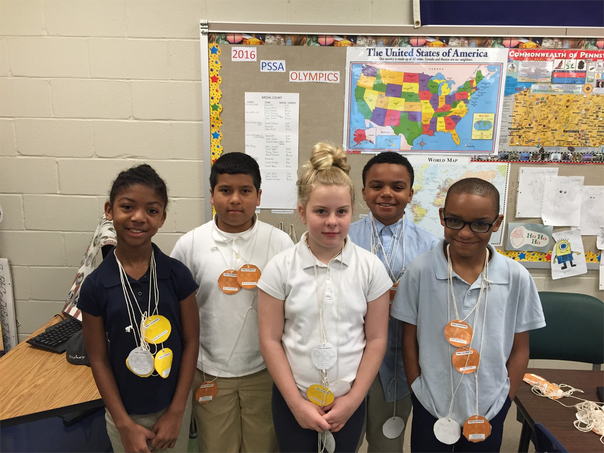 PSSA Olympic winners displaying their medals!