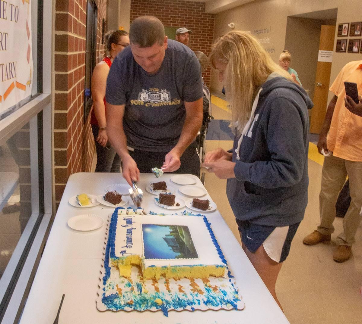 Matt Moyer and Krista cutting cake at rupert 90th