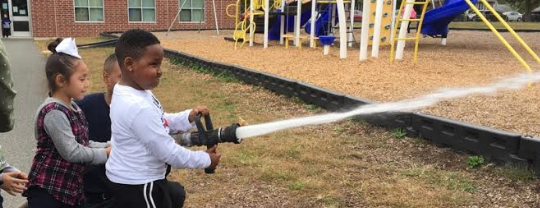 elementary children learning to be firemen and firewomen