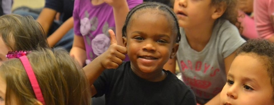 thumbs up from an elementary student