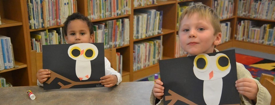 elementary students with owl project