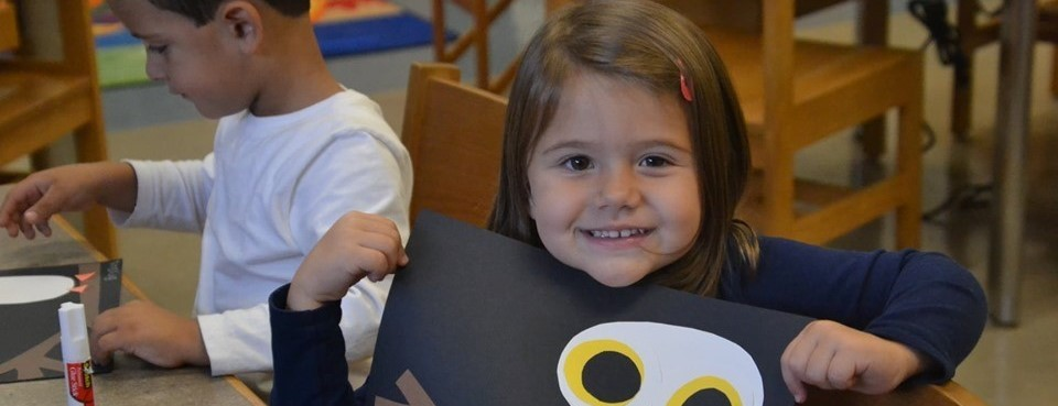 elementary student with owl on branch project