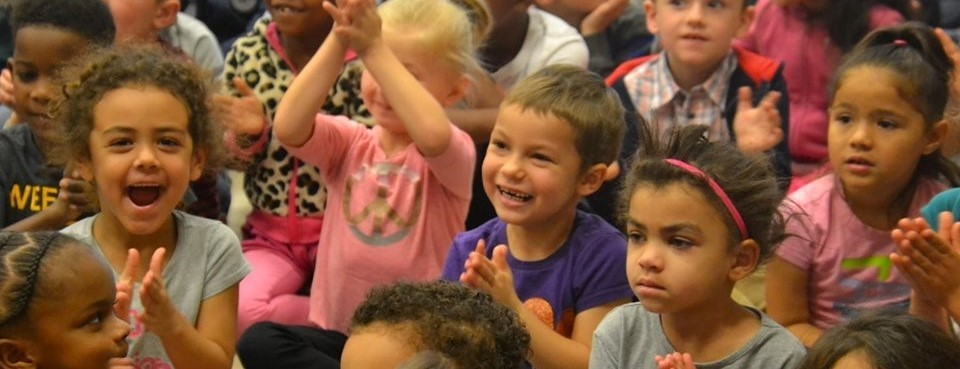 kids clapping at assembly
