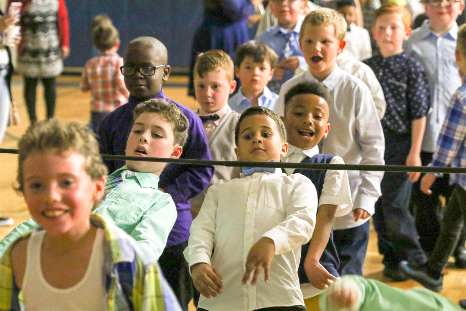 Kids doing limbo