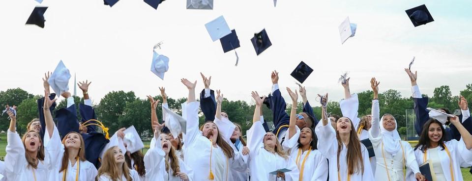 PHS 2019 Graduates throw caps in air