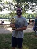 Sam DeAngeli holding trophy