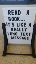 Street sign saying read a book. . .it's like a really long text message